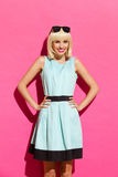 Smiling blonde girl in light blue dress Royalty Free Stock Photos