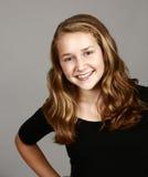 Smiling blonde girl in studio Stock Photo