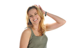 Smiling blonde  in  green t-shirt with raised hand Royalty Free Stock Images