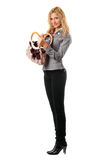 Smiling blonde with a handbag. Isolated Stock Photo