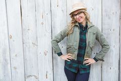 Smiling blonde in hat posing with hands on hips Royalty Free Stock Images
