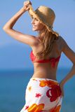 Smiling blonde with hat for sun protection Royalty Free Stock Images