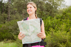 Smiling blonde hiker with map Stock Image