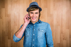 Smiling blonde hipster phone calling Stock Images