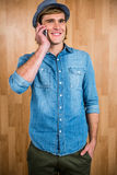Smiling blonde hipster phone calling Stock Photo