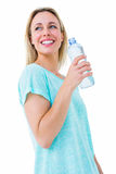 Smiling blonde holding bottle of water Stock Photo