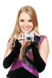 Smiling blonde holding a photo camera. Isolated Royalty Free Stock Images