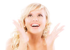 Smiling blonde in joyful admiration Stock Image