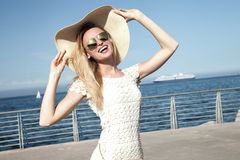 Smiling blonde lady on vacation. Stock Photography