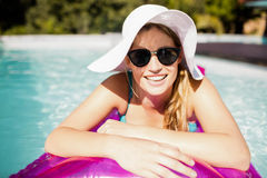 Smiling blonde on lilo Royalty Free Stock Photo