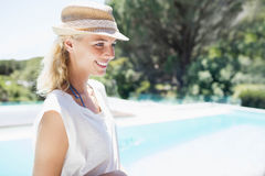 Smiling blonde looking away Royalty Free Stock Images