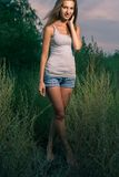 Smiling blonde outdoors toned image stock photos