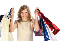 Smiling blonde with paper bags Royalty Free Stock Photos