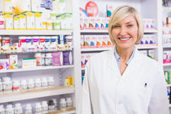 Smiling blonde pharmacist posing in lab coat Stock Images