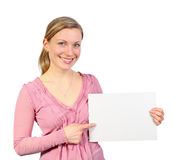 Smiling blonde pointing on empty card Stock Image