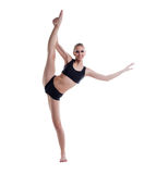 Smiling blonde posing doing vertical split Royalty Free Stock Photo