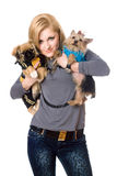 Smiling blonde posing with two dogs Stock Photo