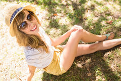 Smiling blonde relaxing in the grass Royalty Free Stock Image