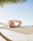 Smiling blonde relaxing on hammock Stock Photo