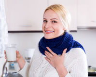 Smiling blonde with scarf Royalty Free Stock Photography