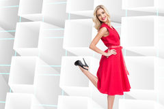 Smiling blonde standing hands on hips Stock Photography