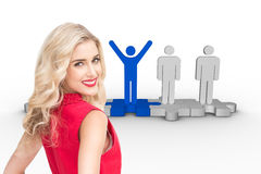 Smiling blonde standing hands on hips Royalty Free Stock Image