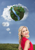 Smiling blonde standing hands on hips. Composite image of smiling attractive blonde standing hands on hips Royalty Free Stock Images