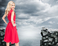Smiling blonde standing hands on hips Stock Images