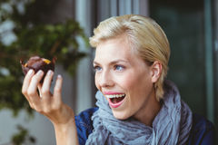 Smiling blonde starring at a muffin cake. At the cafe Royalty Free Stock Photo