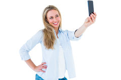 Smiling blonde taking a selfie with smartphone Royalty Free Stock Photos
