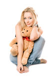 Smiling blonde with a teddy bear Stock Photography