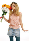 Smiling blonde teen with a bouquet of flowers Royalty Free Stock Photo