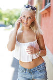 Smiling blonde teen girl talking on the phone Stock Image