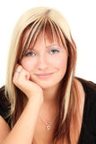 Smiling blonde teenager Stock Images
