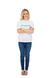 Smiling blonde volunteer posing Stock Images