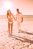 Smiling blonde walking away from man holding her hand Royalty Free Stock Images