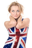 Smiling blonde wearing union-flag shirt Stock Photos