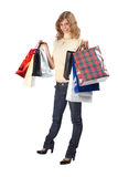 Smiling Blonde With Paper Bags Full Body Royalty Free Stock Photos