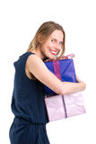 Smiling blonde woman with big gift packages, isolated on white Stock Image