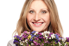 Smiling blonde woman with bouquet Royalty Free Stock Photography