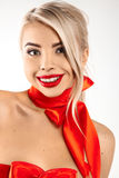 Smiling blonde woman with bows on neck and breast with make up Stock Photo