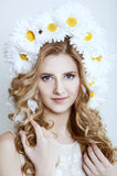 Smiling blonde woman with a camomile wreath Royalty Free Stock Photos