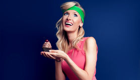 Smiling blonde woman with cupcake. Stock Photo