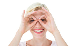 Smiling blonde woman doing funny face Royalty Free Stock Photography