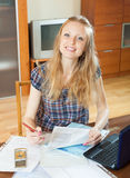 Smiling blonde woman with financial document Royalty Free Stock Image