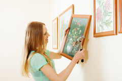 Smiling blonde woman hanging  picture Stock Photography