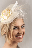 Smiling blonde woman with hat Stock Images