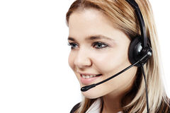 Smiling blonde woman with headphones at call center Royalty Free Stock Image