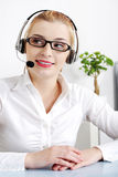 Smiling blonde woman with headset. Royalty Free Stock Photos