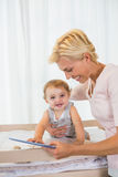 Smiling blonde woman with his son using digital tablet Royalty Free Stock Photography